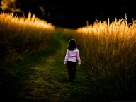 Kid-in-Nature-Little-Girl-Walks-in-Nature-Brown-Wheats-Alongside